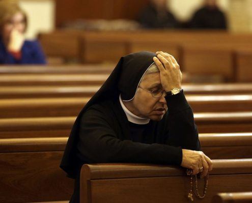 A Maronite nun prays in a church in the center of Beirut on March 18, 2016 as Maronite Christians prepare the mark Easter according to the Catholic calendar. (Patrick Baz/AFP/Getty Images)